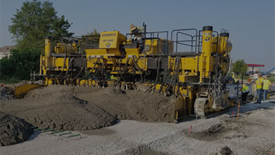 Concrete Technologies, Inc. Paving Machine Close Up Finished Concrete Paving